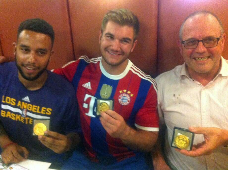 (From L) Anthony Sadler, from Pittsburg, California, Alek Skarlatos from Roseburg, Oregon, and British national Chris Norman who is living in France, hold their medals as they sit in a restaurant after a brief ceremony in the town of Arras, northern France, on August 21, 2015. The American servicemen overpowered a gunman armed with a Kalashnikov who opened fire on a high-speed train travelling from Amsterdam to Paris on August 20, 2015.  Photo: -, AFP / Getty Images