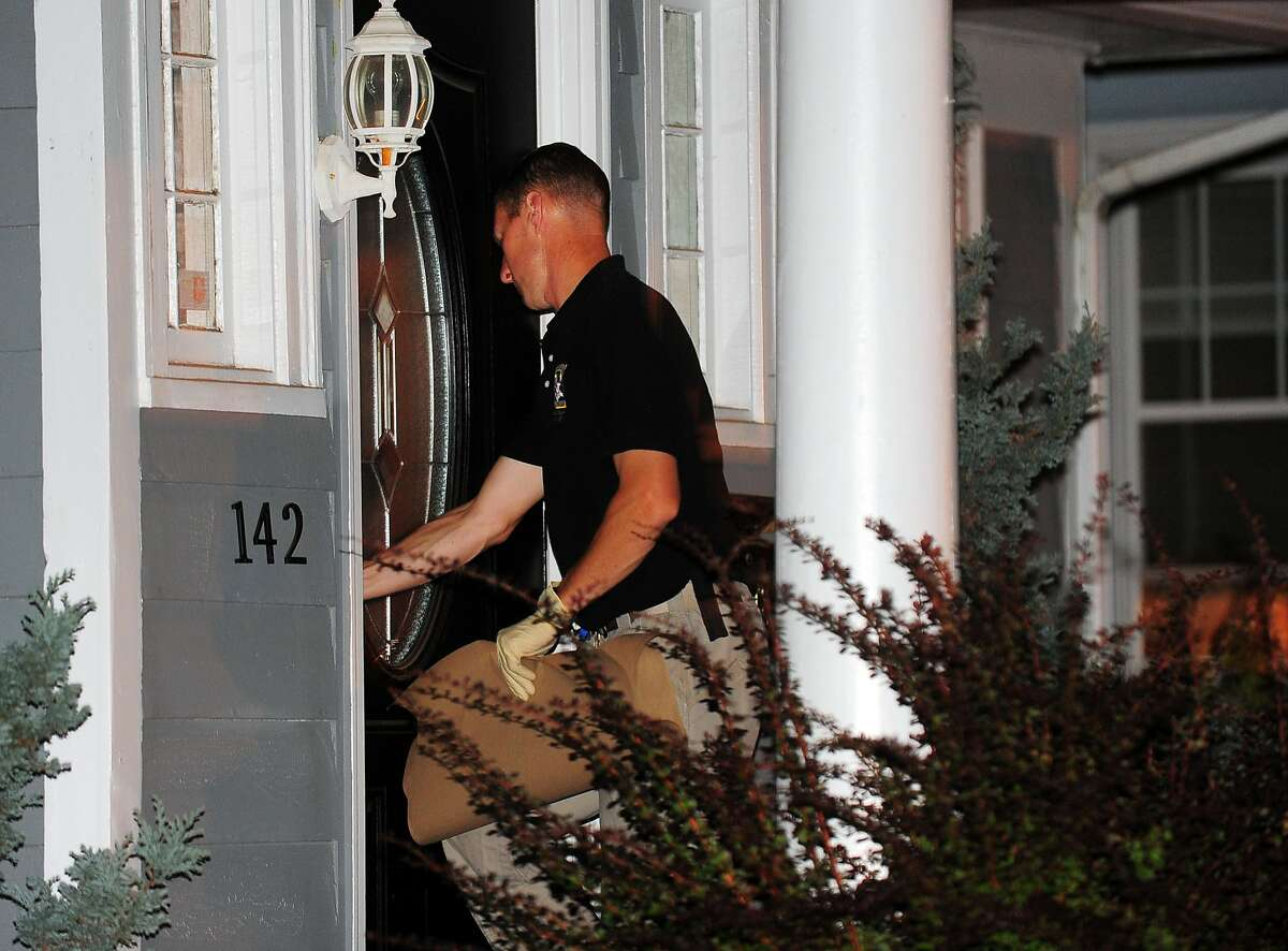 State Police investigate at the home of the son of a missing Easton couple, Jeffrey and Jeanette Navin on Aldine Avenue in Bridgeport, Conn., on Wednesday Aug. 19, 2015. The couple has been missing since Aug. 4, after their car was found off of exit 42 in Westport.
