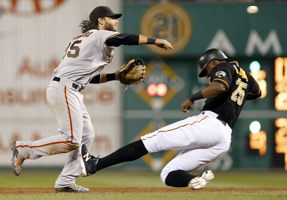 San Francisco Giants shortstop Brandon Crawford throws to first after the force out on Pittsburgh Pirates' Gregory Polanco (25) at second on a ground ball by Starling Marte to complete the double play and end the seventh inning of a baseball game, Friday, Aug. 21, 2015, in Pittsburgh. The Giants won 6-4. (AP Photo/Keith Srakocic) Photo: Keith Srakocic, Associated Press