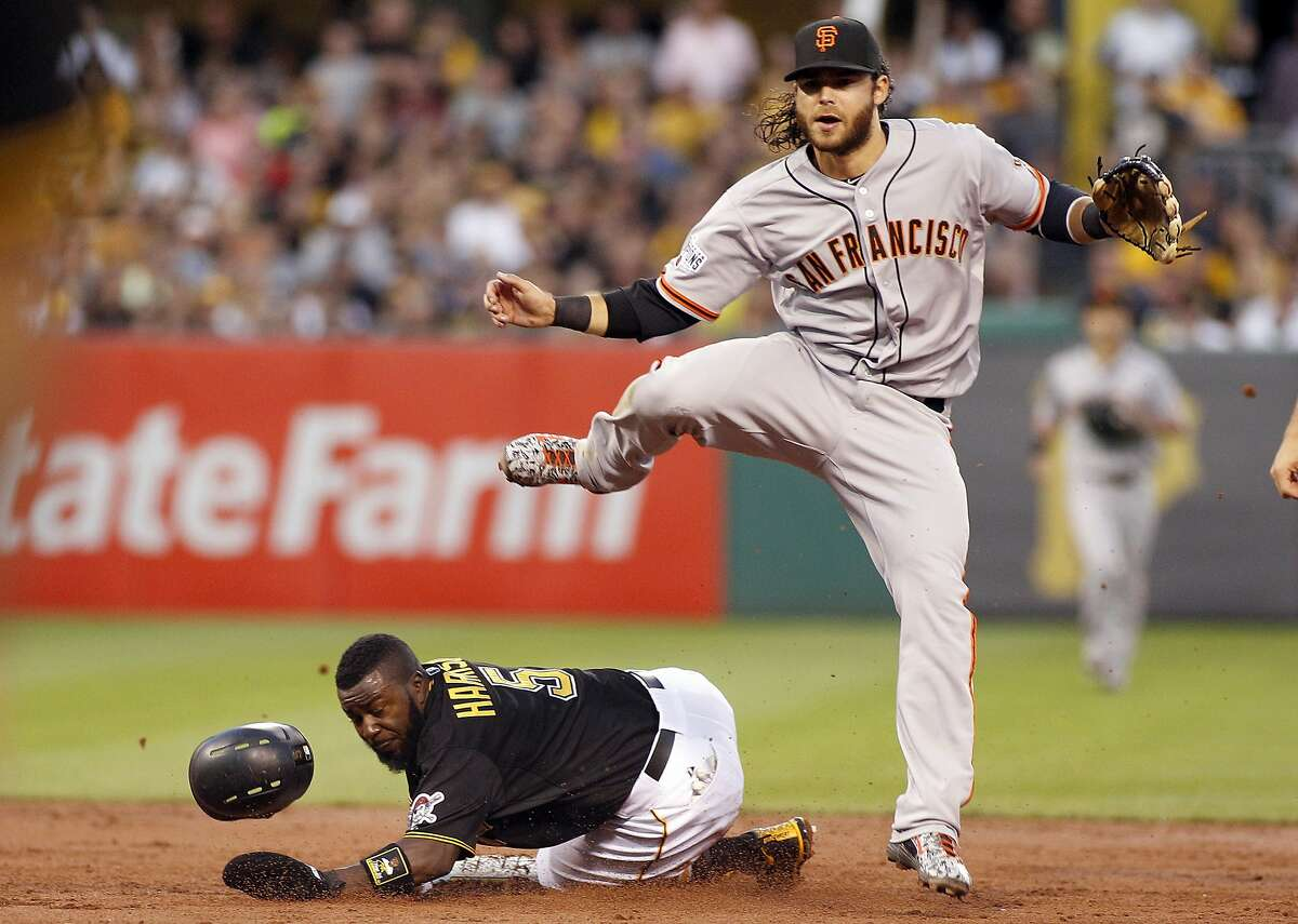 Brandon Crawford #35 of the San Francisco Giants attempts a double play in the second inning during the game against Josh Harrison #5 of the Pittsburgh Pirates at PNC Park on August 21, 2015 in Pittsburgh, Pennsylvania.