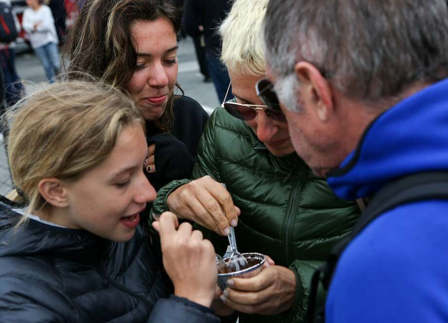 (Left to Right) -- Matilde Rossi, Vittoria Rossi, Federica Conego, and Carlo Rossi share a dessert from Creme Brulee Cart at Off The Grid on Friday, August 21, 2015 in San Francisco, Calif. Photo: Amy Osborne, Special To The Chronicle