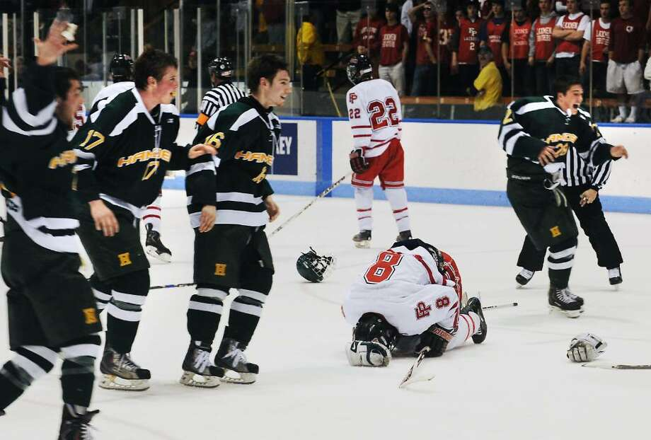 Fairfield Prep's Darric White drops to the ice as Hamden celebrates their 6-5 win over Prep in the CIAC boys hockey championship game in New Haven, Conn. on Saturday, March 20, 2010. Photo: Kathleen O'Rourke / Stamford Advocate