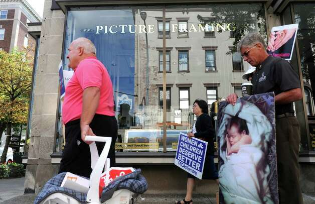 Pro-Life Action League supporters protest outside the Troy Farmers Market as part of National Day of Protest Against Planned Parenthood regarding recent accudations against the agency on Saturday Aug. 22, 2015 in Troy, N.Y.  (Michael P. Farrell/Times Union) Photo: Michael P. Farrell / 00033088A