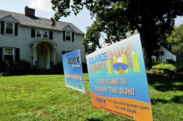 Workers with Apex Solar at a home on Wednesday, Aug. 19, 2015, in Delmar, N.Y.  The home is being done through the Solarize Albany program.    (Paul Buckowski / Times Union) Photo: PAUL BUCKOWSKI / 00033062A