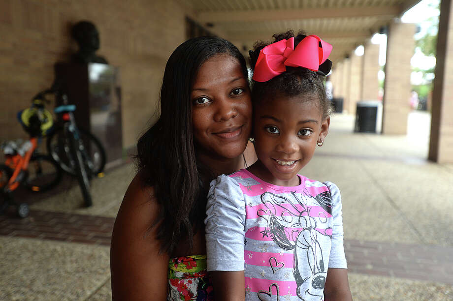 Jessica Richard and Brianna Ballard, 5, were at the Beaumont Police Department's annual Cops and Kids Carnival Saturday at the Beaumont Civic Center. Families worked their way through the various informational booths, carnival games and children's activities, having fun while also taking in lessons about personal safety. Photo taken Saturday, August 22, 2015 Kim Brent/The Enterprise Photo: Kim Brent / Beaumont Enterprise
