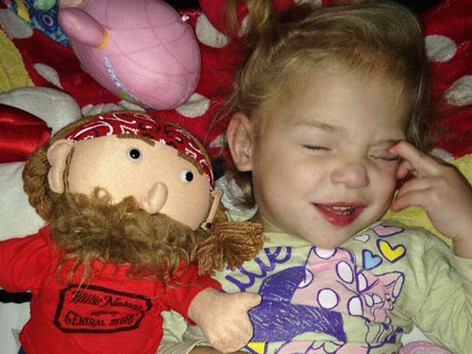 Ava Adams, 4, is seen here with her prized Willie Nelson doll. Her parents are crediting Nelson's music for helping her get through severe medical troubles after she was born premature. (Photo: NewsChannel 10 / KFDA-TV Amarillo)