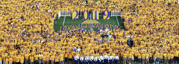 2540 UAlbany freshman pose for a Class of 2019 photo on Bob Ford Field at the university Saturday August 22, 2015 in Albany, NY.  (John Carl D'Annibale / Times Union) Photo: John Carl D'Annibale / 00033085A