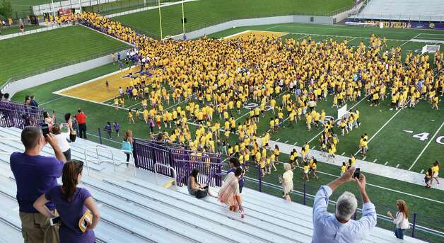 Parents and friends of the 2540 UAlbany freshman class take pictures after the students posed for a class photo on Bob Ford Field at the university Saturday August 22, 2015 in Albany, NY.  (John Carl D'Annibale / Times Union) Photo: John Carl D'Annibale / 00033085A