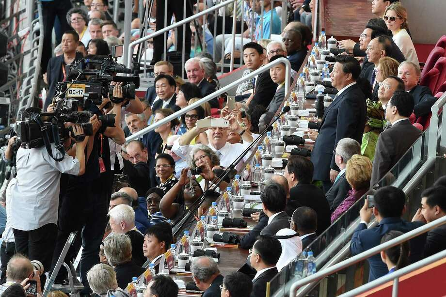 "China's President Xi Jinping (top R) attends the opening ceremony of the 2015 IAAF World Championships athletics event at the ""Bird's Nest"" National Stadium in Beijing on August 22, 2015.   AFP PHOTO / FRANCK FIFEFRANCK FIFE/AFP/Getty Images ORG XMIT: 565927779 Photo: FRANCK FIFE / AFP or licensors"