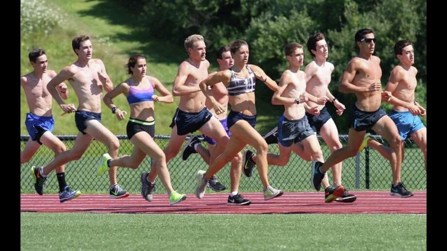 Campers and counselors at the Oregon-Style Cross Country Running Camp at the Canterbury School in New Milford trained with Connecticut native and 2012 Olympic steeplechaser Donn Cabral as he prepared for the IAAF World Track and Field Championships in Beijing. Pictured during a track workout at Brookfield High School are (from left) Connor McNerney, Parker Timmerman, Jess Wojnicki, Spencer Mannion, Tommy Consalvo, Maggie Christe, Chris Rivas, Mike McGonnigle, Cabral and Mike Bortolot. Photo: Contributed / Contributed / News-Times Contributed