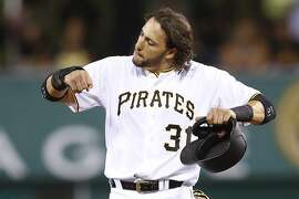Pittsburgh Pirates' Michael Morse pumps his arms and kicks his feet up Neil Walker's single moved him up to second base in the eighth inning of a baseball game between the Pittsburgh Pirates and the Arizona Diamondbacks, Monday, Aug. 17, 2015, in Pittsburgh. The Diamondbacks won 4-1.  (AP Photo/Keith Srakocic)