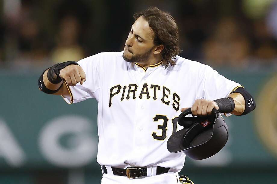 Pittsburgh Pirates' Michael Morse pumps his arms and kicks his feet up Neil Walker's single moved him up to second base in the eighth inning of a baseball game between the Pittsburgh Pirates and the Arizona Diamondbacks, Monday, Aug. 17, 2015, in Pittsburgh. The Diamondbacks won 4-1.  (AP Photo/Keith Srakocic) Photo: Keith Srakocic, Associated Press