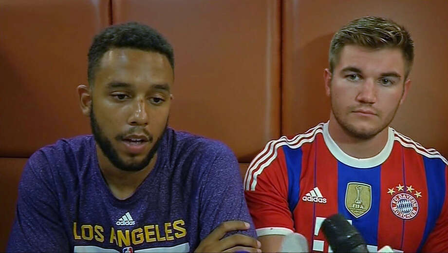 In this image made from TV, Anthony Sadler, a senior at Sacramento State University, left, sits with Alek Skarlatos, US National Guardsman from Roseburg, Oregon, who both helped overpower high-speed train attacker, talk to the media early Saturday Aug. 22, 2015, in Arras, France.  Three Americans and a Briton are together being hailed as heroes for tackling and disarming a gunman aboard a high-speed train traveling between Amsterdam and Paris Friday evening. (AP Photo /APTN) TV OUT - FRANCE OUT ORG XMIT: LON803 / aptn