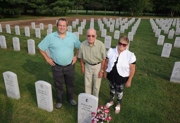 WWII army veteran Jerry Winters, center, and his daughter Geri Wiley, right, and son Jeff Winters at his wife Eleanor Winters ,a WWII era Navy veteran , grave at Saratoga National Cemetery on Tuesday Aug. 18, 2015 in Schuylerville, N.Y.  (Michael P. Farrell/Times Union) Photo: Michael P. Farrell / 00033036A