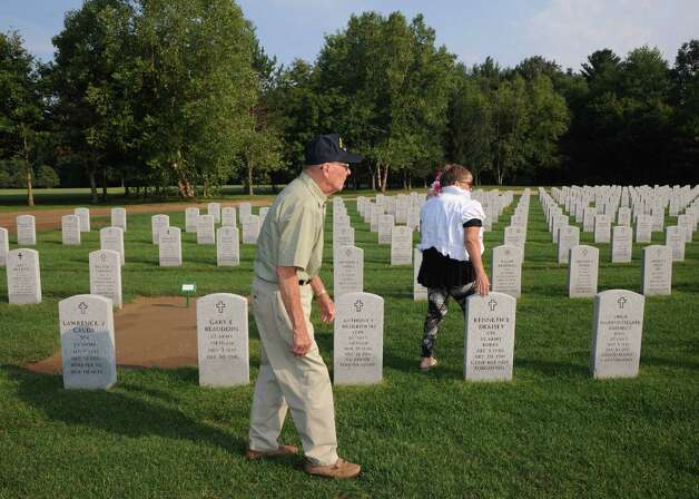 WWII army veteran Jerry Winters, center, and his daughter Geri Wiley at his wife Eleanor Winters ,a WWII era Navy veteran , grave at Saratoga National Cemetery on Tuesday Aug. 18, 2015 in Schuylerville, N.Y.  (Michael P. Farrell/Times Union) Photo: Michael P. Farrell / 00033036A