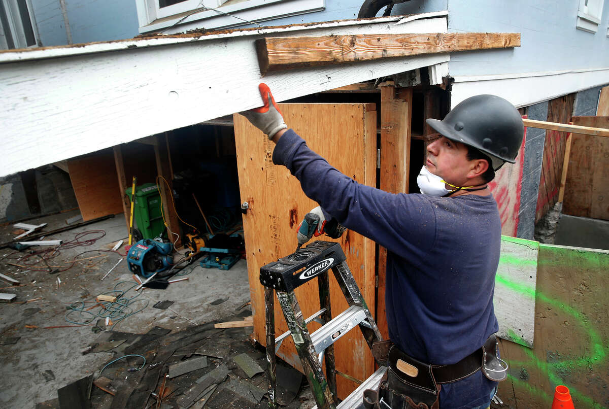 Alberto Jimenez works on a soft-story apartment building on Lake Street in San Francisco to strengthen it for seismic safety.
