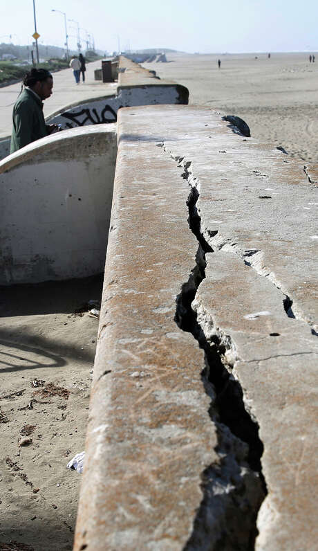 Left: Parts of the nearly 100-year-old O'Shaugh nessy Seawall at Ocean Beach, shown in March, are deteriorating.   Right: Alberto Jimenez works on a soft-story apartment building on Lake Street to strengthen it for seismic safety. Photo: Liz Hafalia / Liz Hafalia / The Chronicle / ONLINE_YES