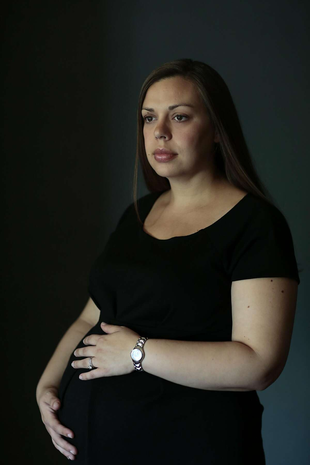 Rachel Miller poses for a portrait at her home in Redding, California, Saturday, August 22, 2015. Mrs. Miller, a Redding lawyer and pregnant mother, is due to give birth by C-section on Sept. 29 and wants to have her doctor perform a tubal ligation that the hospital, Mercy Medical Center in Redding, refuses to allow because of Catholic doctrine. Her ACLU lawyer says she'll sue if the hospital doesn't change its mind. Ramin Rahimian/Special to The Chronicle
