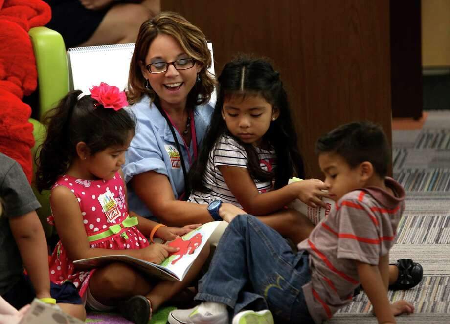 Pre-K 4 SA instructor Christina Martinez reads with students in 2013. The citywide early education program was approved by a margin of 53 percent in 2012. By 2015, Pre-K 4 SA was serving kids in four city centers and training teachers. Photo: Express-News File Photo / ©2013 San Antonio Express-News
