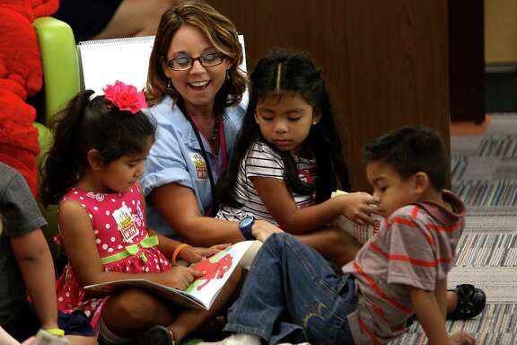 Pre-K 4 SA instructor Christina Martinez reads with students in 2013. The citywide early education program was approved by a margin of 53 percent in 2012. By 2015, Pre-K 4 SA was serving kids in four city centers and training teachers.
