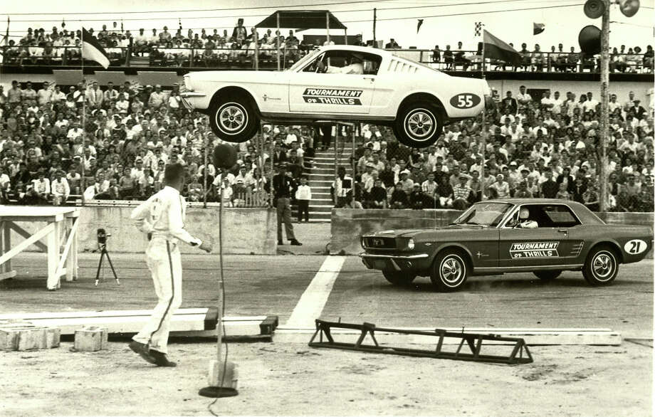 A Ford Mustang flies through the air at the auto thrill shows stage at the Pan American Speedway on Austin Highway. Auto thrill shows attracted audiences with death-defying jumps and intentional crashes by professional stunt drivers. The Pan American Speedway was a longtime venue for these exhibitions. Photo: Courtesy Of Ed Bowles Jr.