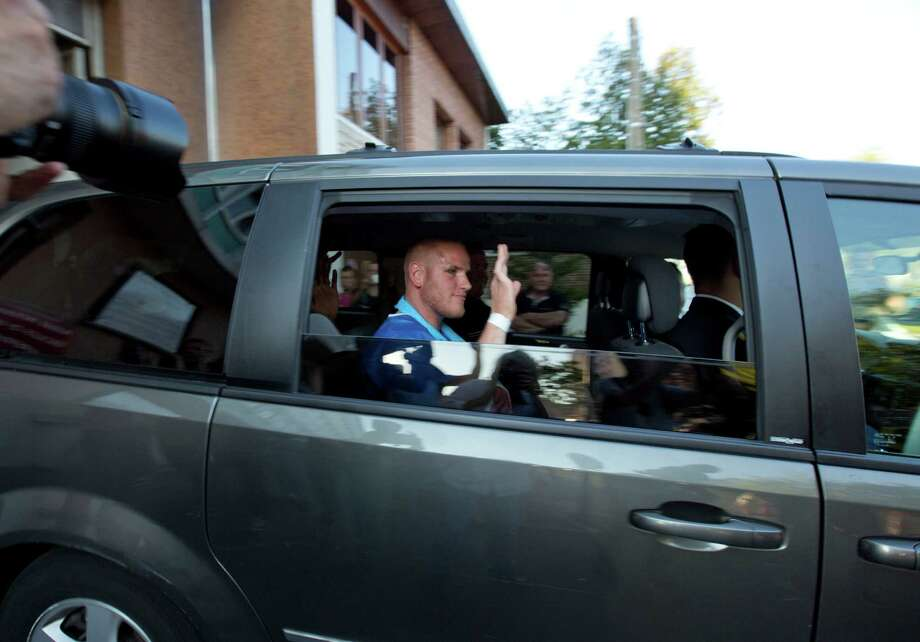 U.S. Spencer Stone waves as he leaves the police station in Arras, northern France, Saturday, Aug. 22, 2015. A gunman  prepared to open fire with an automatic weapon on a high-speed train traveling from Amsterdam to Paris Friday, wounding several people before being subdued by passengers, officials said. Spencer Stone is one of the passengers credited with subduing the gunman. (AP Photo/Virginia Mayo) Photo: Virginia Mayo, STF / AP