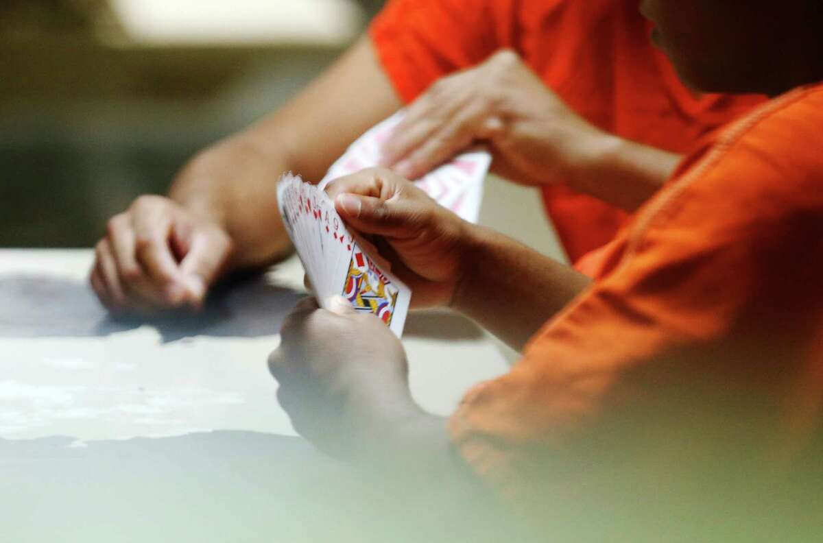 Inmates play a card game in the common area at the La Salle County Detention Center, which is operating at about half-capacity. Officials hope the facility can break even if it reaches about 300 occupants.