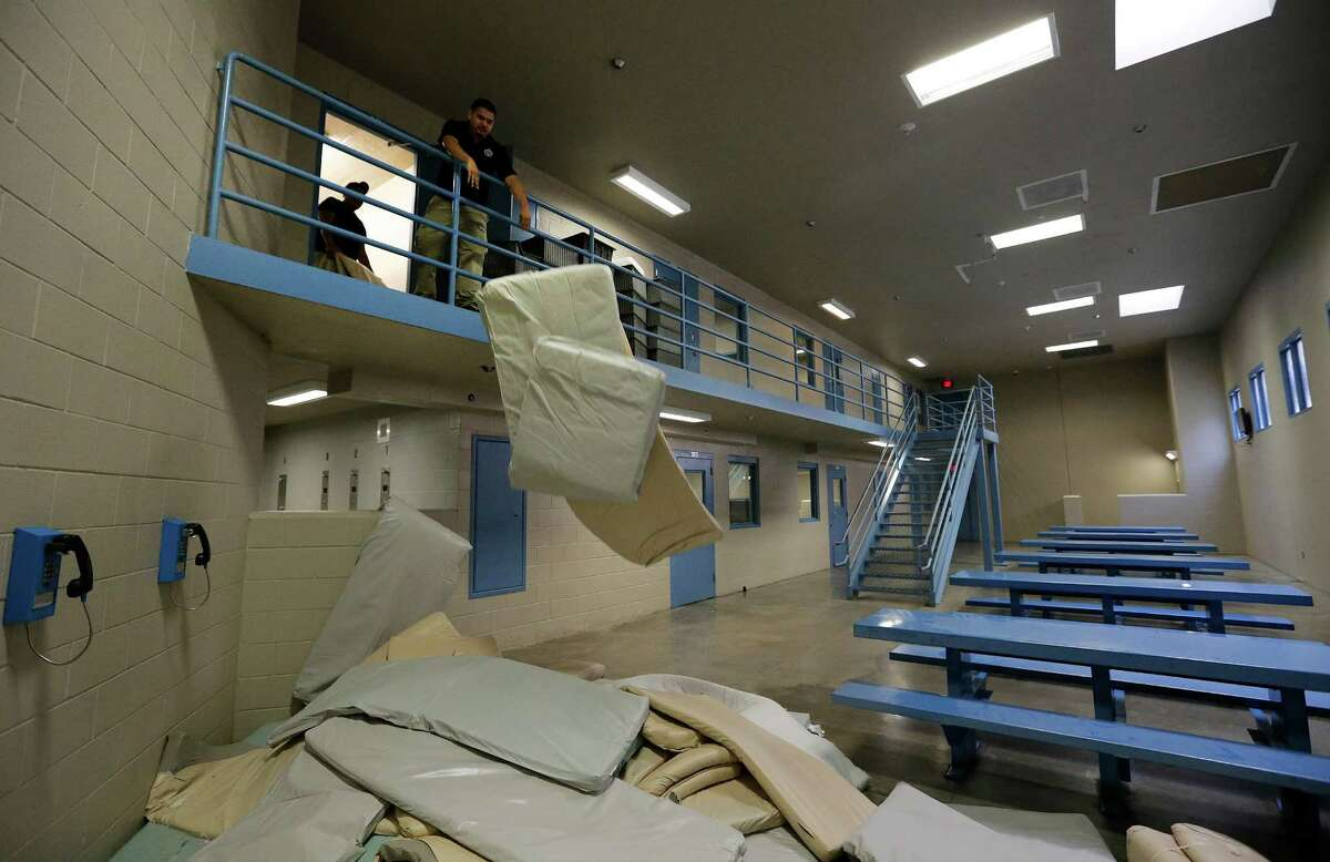 Mattresses are removed from a pod inside the Maverick County Detention Center that was once privately operated by Geo Group, Inc. After county officials and Geo could not come to terms for a new contract, Geo pulled out of Maverick County leaving officials and the shareholders of the facility wondering what would become of the detention center. The facility that could house over 600 inmates is now empty and the remaining employees are facing unemployment. (Kin Man Hui/San Antonio Express-News)