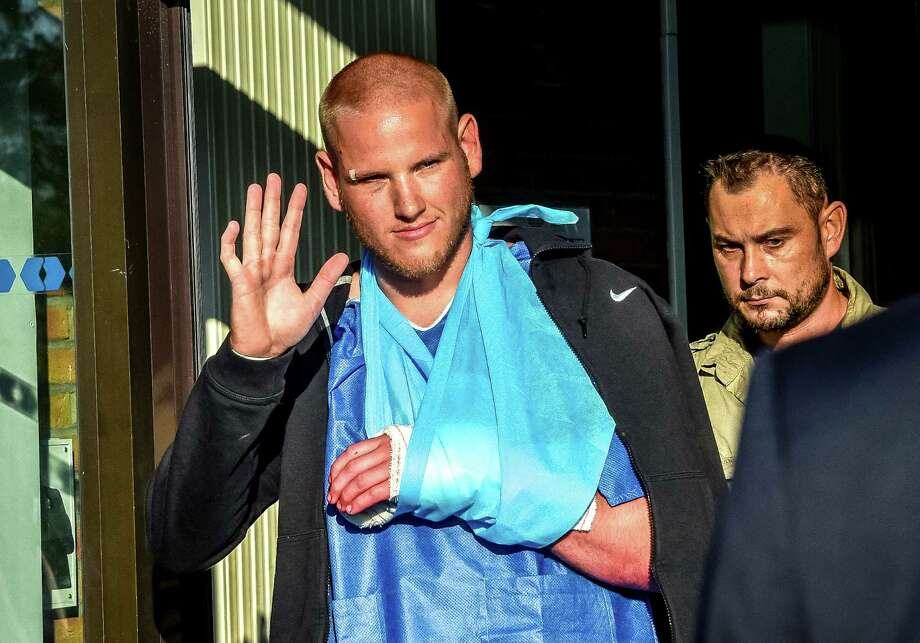 Off-duty U.S. Airman 1st Class Spencer Stone leaves a hospital in northern France after being treated for cuts the train gunman inflicted with a box cutter. Stone was the first man who jumped the gunman. Photo: Philippe Huguen /Getty Images / AFP