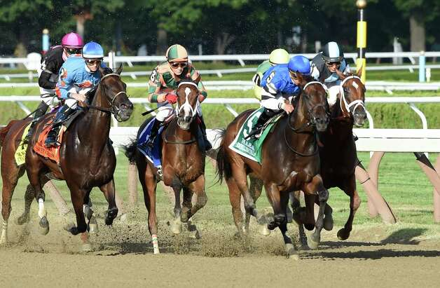 Embellish the Lace with jockey Javier Castellano lead wire to wire here passing the stands for the first time in the 135th running of the Alabama at the Saratoga Race Course Saturday evening Aug. 22, 2015 in Saratoga Springs, N.Y.      (Skip Dickstein/Times Union) Photo: SKIP DICKSTEIN