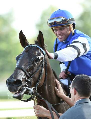 Jockey Javier Castellano gives Embellish the Lace a pat on the head after winning the 135th running of the Alabama at the Saratoga Race Course Saturday evening Aug. 22, 2015 in Saratoga Springs, N.Y.      (Skip Dickstein/Times Union) Photo: SKIP DICKSTEIN