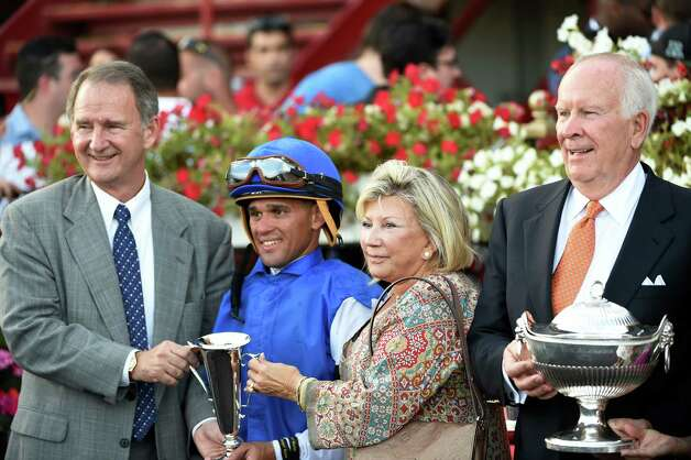 NYRA CEO Chris Kay, left present Jockey Javier Castellano and Mr and Mrs. Alex Lieblong, owners the winner's trophy after Embellish the Lace won the 135th running of the Alabama at the Saratoga Race Course Saturday evening Aug. 22, 2015 in Saratoga Springs, N.Y.      (Skip Dickstein/Times Union) Photo: SKIP DICKSTEIN