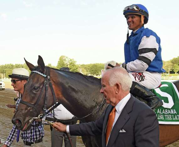 Embellish the Lace with jockey Javier Castellano is lead to the winner's circle by owner Alex Lieblong after his charge won the 135th running of the Alabama at the Saratoga Race Course Saturday evening Aug. 22, 2015 in Saratoga Springs, N.Y.      (Skip Dickstein/Times Union) Photo: SKIP DICKSTEIN