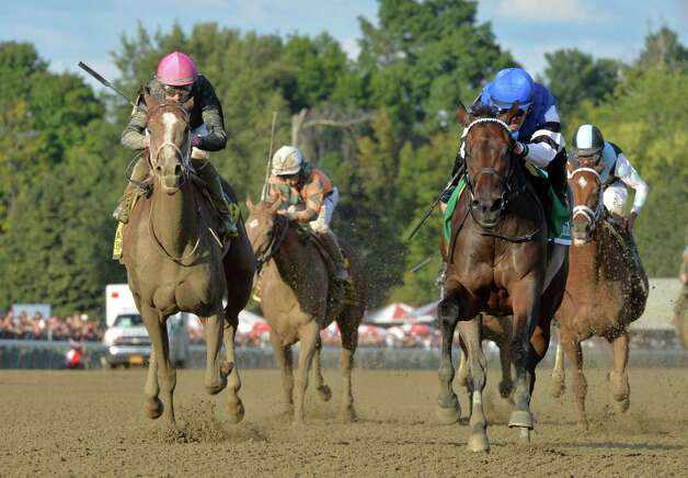 Embellish the Lace with jockey Javier Castellano, right wins the 135th running of the Alabama at the Saratoga Race Course Saturday evening Aug. 22, 2015 in Saratoga Springs, N.Y.      (Skip Dickstein/Times Union) Photo: SKIP DICKSTEIN
