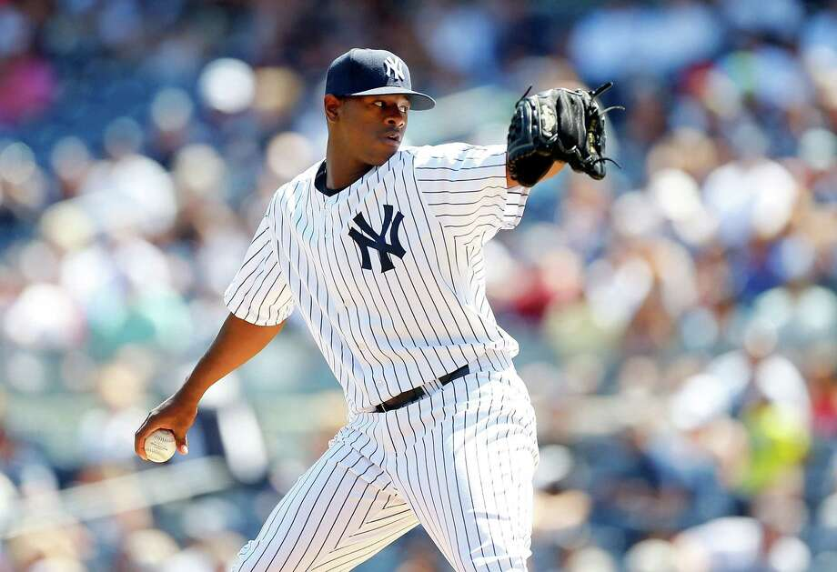 NEW YORK, NY - AUGUST 22:  Luis Severino #40 of the New York Yankees pitches in the first inning against the Cleveland Indians at Yankee Stadium on August 22, 2015 in the Bronx borough of New York City.  (Photo by Jim McIsaac/Getty Images) ORG XMIT: 538591423 Photo: Jim McIsaac / 2015 Getty Images