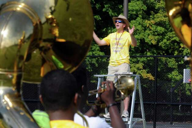 Band director Kevin Champagne leads his musicians through their paces as the Marching Great Danes practice at University at Albany on Friday Aug. 21, 2015 in Albany, N.Y.  (Michael P. Farrell/Times Union) Photo: Michael P. Farrell / 00033045A