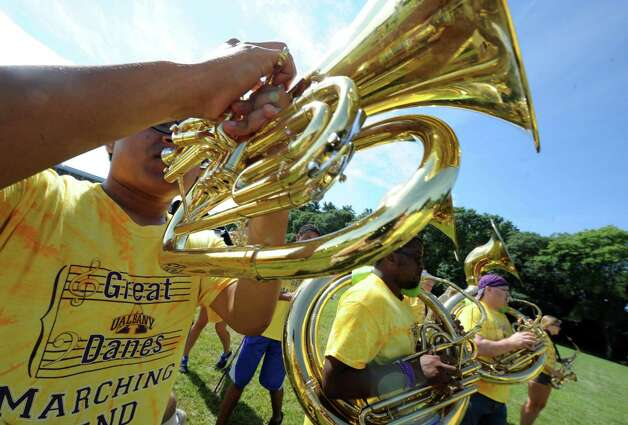 Andrew Salas, left, plays the euphonium as the Marching Great Danes practice at University at Albany on Friday Aug. 21, 2015 in Albany, N.Y.  (Michael P. Farrell/Times Union) Photo: Michael P. Farrell / 00033045A