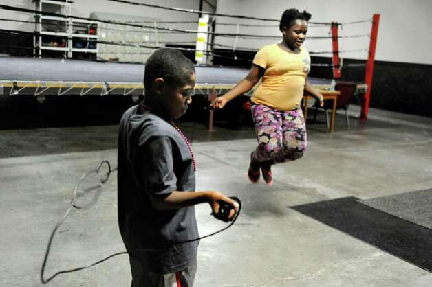Deandre Taylor, 11, left, and Brianna Brown, 10, jump rope during the grand opening of the Lord's Gym on Saturday, Aug. 22, 2015, at The Bridge Christian Church in Schenectady, N.Y. (Cindy Schultz / Times Union) Photo: Cindy Schultz / 00032810A