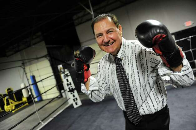Pastor James Bookhout takes a stance in the boxing ring during the grand opening of the Lord's Gym on Saturday, Aug. 22, 2015, at The Bridge Christian Church in Schenectady, N.Y. (Cindy Schultz / Times Union) Photo: Cindy Schultz / 00032810A