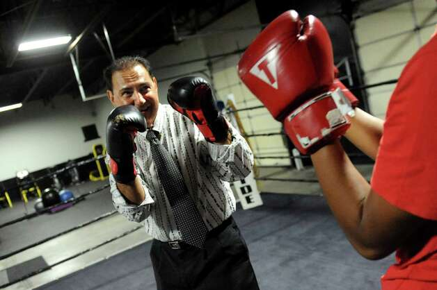 Pastor James Bookhout spars in the boxing ring during the grand opening of the Lord's Gym on Saturday, Aug. 22, 2015, at The Bridge Christian Church in Schenectady, N.Y. (Cindy Schultz / Times Union) Photo: Cindy Schultz / 00032810A