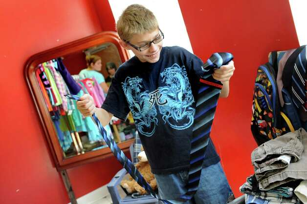 Ryan Snyder, 13, of Watervliet looks through the ties during the Pay It Forward Together sponsored Back-to-School Closet on Saturday, Aug. 22, 2015, at Bethany Presbyterian Church in Menands, N.Y. (Cindy Schultz / Times Union) Photo: Cindy Schultz / 00033044A