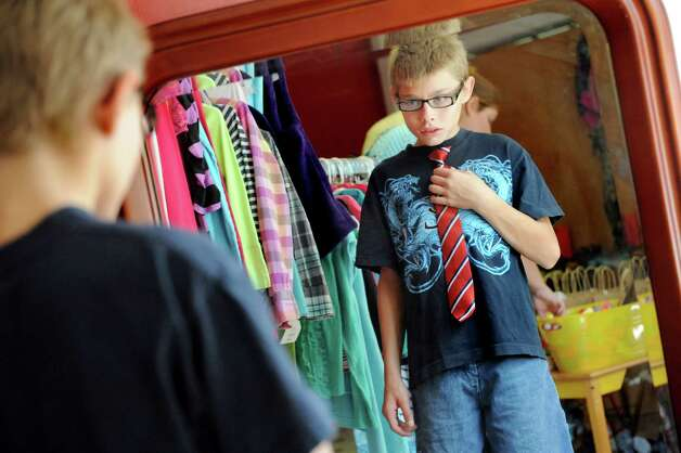 Ryan Snyder, 13, of Watervliet finds a clip-on tie for his band concerts during the Pay It Forward Together sponsored Back-to-School Closet on Saturday, Aug. 22, 2015, at Bethany Presbyterian Church in Menands, N.Y. (Cindy Schultz / Times Union) Photo: Cindy Schultz / 00033044A
