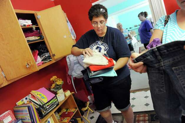 Volunteer Lisa Green helps Andrea Snyder of Watervliet find girls pants during the Pay It Forward Together sponsored Back-to-School Closet on Saturday, Aug. 22, 2015, at Bethany Presbyterian Church in Menands, N.Y. (Cindy Schultz / Times Union) Photo: Cindy Schultz / 00033044A