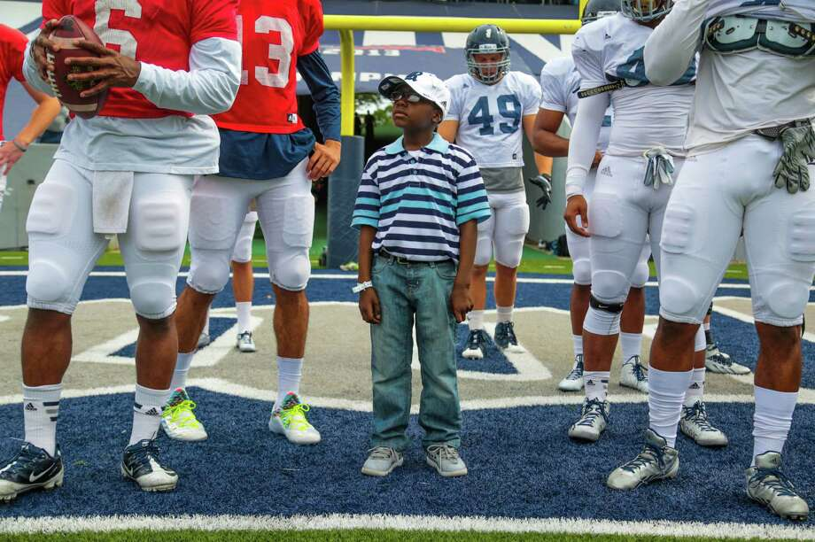 Ziggy Stoval-Redd moved from Mississippi to Katy to be closer to doctors treating his acute lymphoblastic leukemia, now in remission. Team IMPACT, a Boston-based nonprofit, connected him with Rice's football team. Photo: Billy Smith II / © 2015 Houston Chronicle