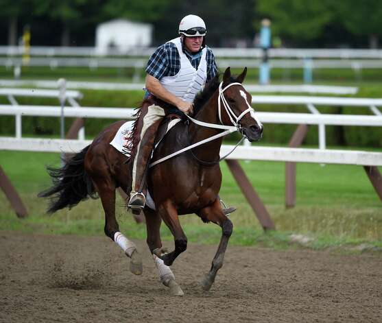 Lovely Maria with trainer Larry Jones in the saddle goes out for her morning exercise on the main track of the Saratoga Race Course Aug. 20, 2015.  Lovely Maria will appear next in the Alabama on Saturday.    (Skip Dickstein/Times Union) Photo: SKIP DICKSTEIN