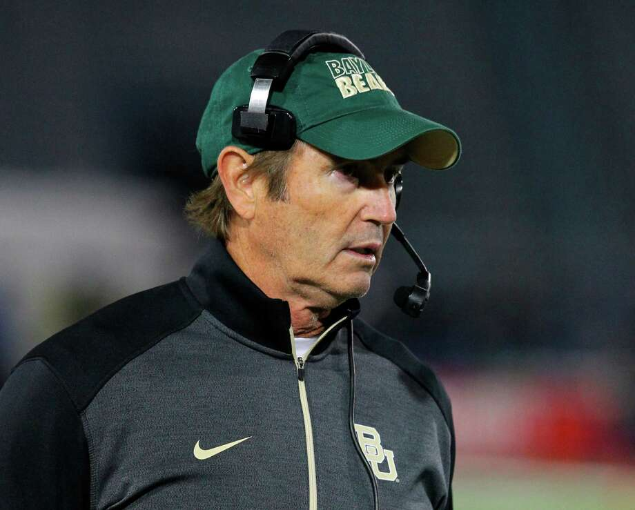 "FILE - In this Sept. 12, 2014, file photo, Baylor coach Art Briles walks the sideline during his team's NCAA college football game against Buffalo in Amherst, N.Y. Baylor University will conduct an investigation into the school's handling of sexual assault allegations against a football player who was allowed to transfer into Briles' program despite a history of disciplinary problems at Boise State. Following the conviction of defensive end Sam Ukwuachu on sexual assault charges, Baylor President Ken Starr on Friday, Aug. 21, 2015, called for a ""comprehensive internal inquiry into the circumstances associated with the case and the conduct of the offices involved."" (AP Photo/Bill Wippert, File) Photo: Bill Wippert, FRE / Associated Press / FR170745 AP"