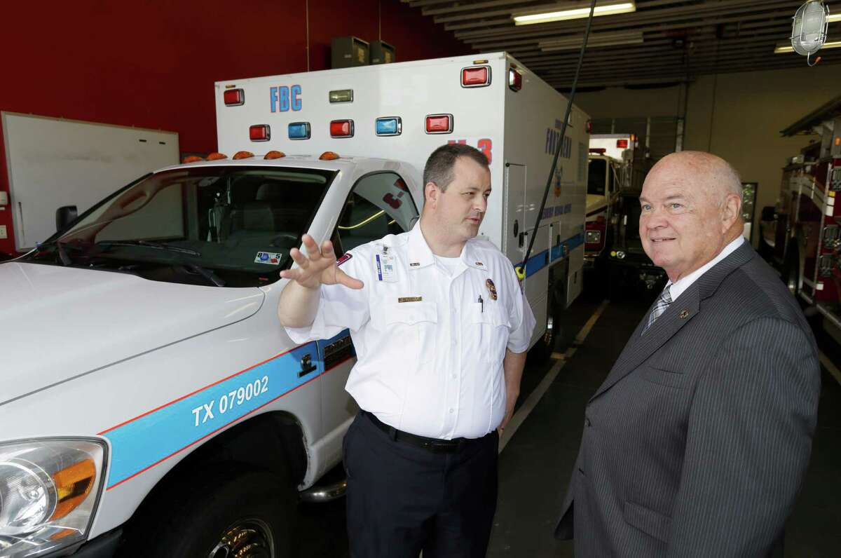 Fort Bend EMS Director Graig Temple, left, and County Judge Bob Hebert want to increase the county's EMS budget to $13 million for fiscal 2016 to address poor response times.