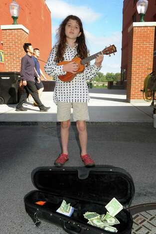Eight-year-old Josephine Monder of Hebron plays ukulele at the Troy Farmers Market on Saturday Aug. 22, 2015 in Troy, N.Y.  (Michael P. Farrell/Times Union) Photo: Michael P. Farrell