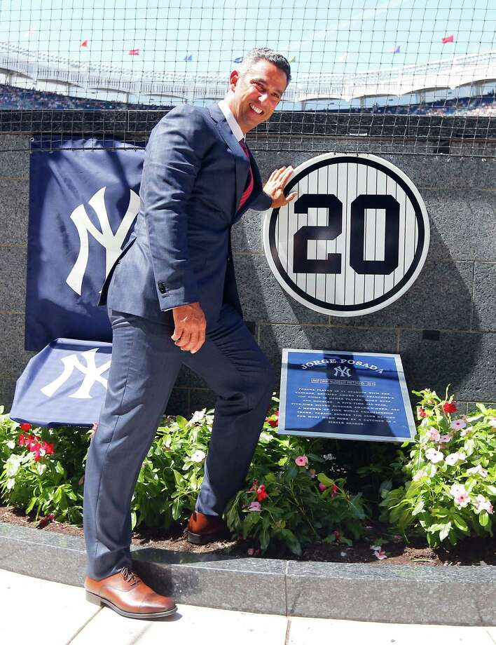 NEW YORK, NY - AUGUST 22:  Former New York Yankee Jorge Posada poses for a photograph with his retired number plaque in Monument Park during a ceremony before the Yankees play against the Cleveland Indians at Yankee Stadium on August 22, 2015 in the Bronx borough of New York City.  (Photo by Jim McIsaac/Getty Images) ORG XMIT: 538591423 Photo: Jim McIsaac / 2015 Getty Images