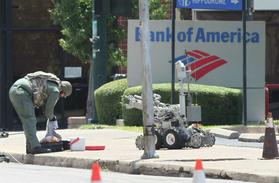 A suspicious cooler and suitcase led a bomb squad to disperse a rally Saturday in Waco, but no hazardous materials were found. Photo: Jerry Larson, MBO / Waco Tribune-Herald